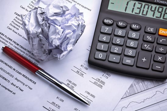 money management with calculator and pen